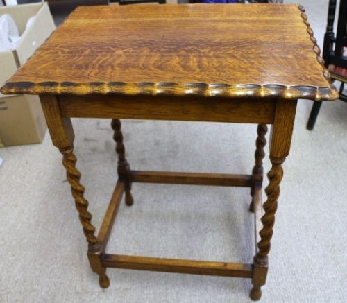 Edwardian Oak Table with 4 barley twist legs and pie crust edging. Measures 28 inches in height, top measures 24 inches x 18 inches.