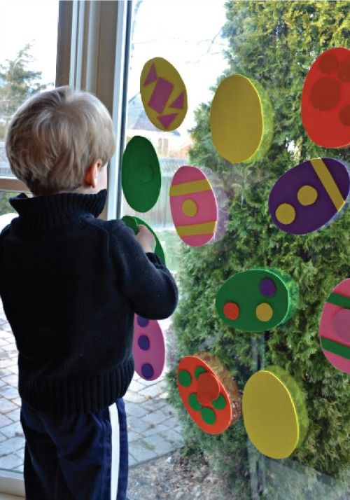 Get sticky with fun egg window art for kids.