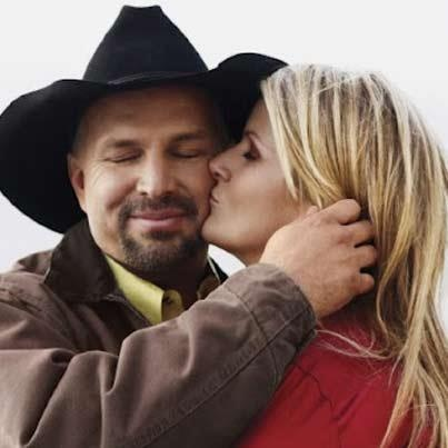 Garth Brooks and Trisha Yearwood, I love them together. They always had such amazing chemistry & they are so in love. My two favorite country singers ended up together.....that's cool.