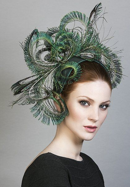 R1691 - Curled peacock feather headdress on silk crescent