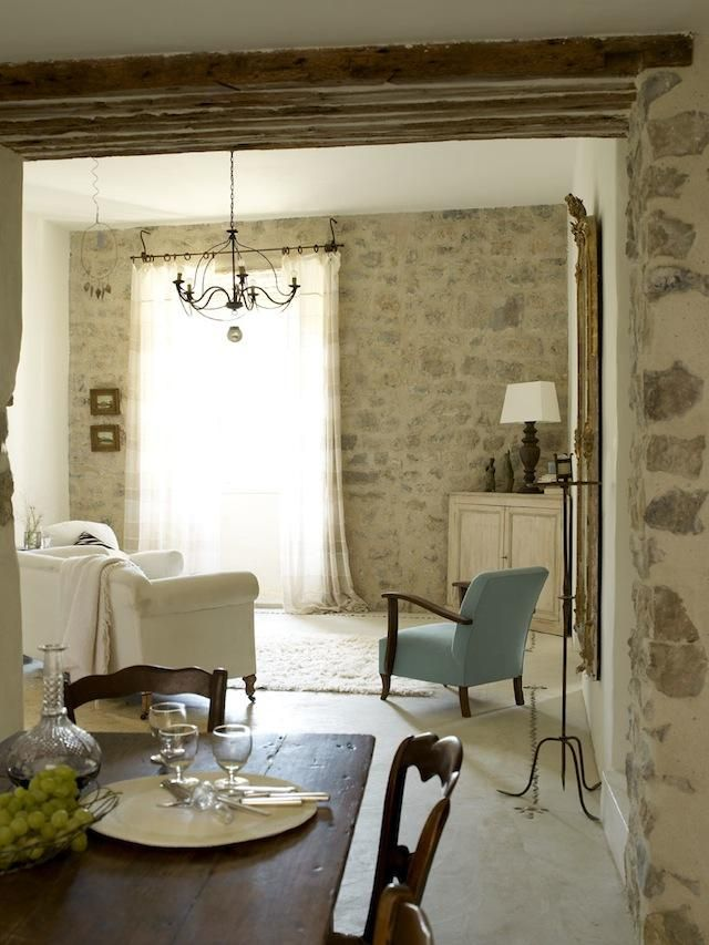 The dining table and sofa came from the couple's London home. The white mohair throw is from The White Company, and the 1930s retro chair and painted corner cupboard are from local shops  http://www.houselafrance.com/gallery.html#