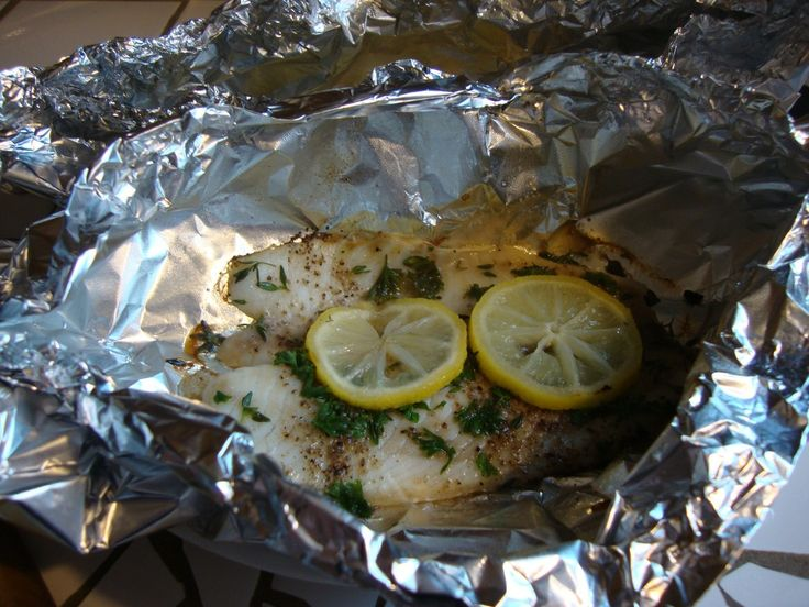 Lemon and Herbed Tilapia Foil Packets --- I did mine in the oven instead of grill and still came out awesome.  The only way I make Tilapia now.  And it's healthy!