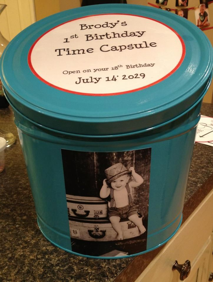 Cool Idea..1st Birthday Time Capsule - spray paint an old tin and mod podge a picture from baby's one year shoot and a message.  Ask everyone to bring something for it, and have everyone sign the tin as well. I think you could do it every year