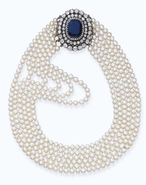 An antique Natural Pearl Necklace with Sapphire and Diamond clasp, circa 1890. Christie's. (=)
