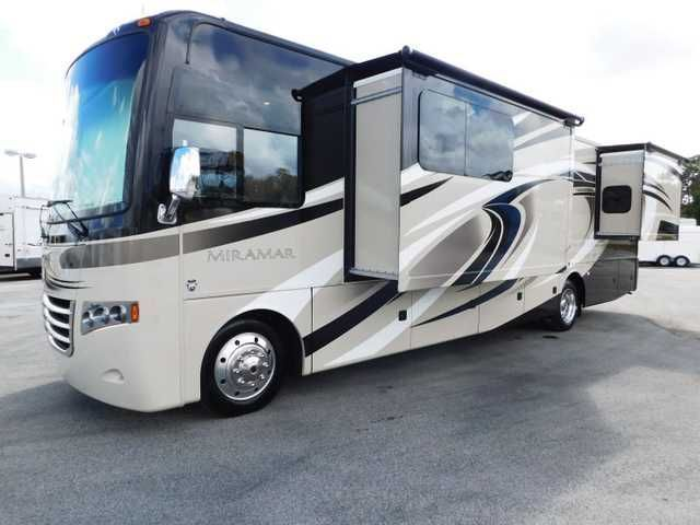 "2016 New Thor Motor Coach MIRAMAR 34.4 2 SLIDES KING BED THEATER SEATING 3 TVS Class A in Florida FL.Recreational Vehicle, rv, CALL MAX GABBARD AT 352-942-3478 FOR AVAILABILITY & DETAILS.........JUST IN........2016 MIRAMAR CLASS A ( MODEL 34.4 ) by THOR MOTOR COACH.......JUST RELEASED FLOOR PLAN.........22.5 ALCOA WHEELS......2 SLIDE-OUTS........LARGE BASEMENT PASS-THRU STORAGE.......OUTSIDE 32"" TV.......OUTSIDE KITCHEN & GAS GRILL......BACKUP CAMERA & SIDE VIEW CAMERA'S......LCI LEVELING"