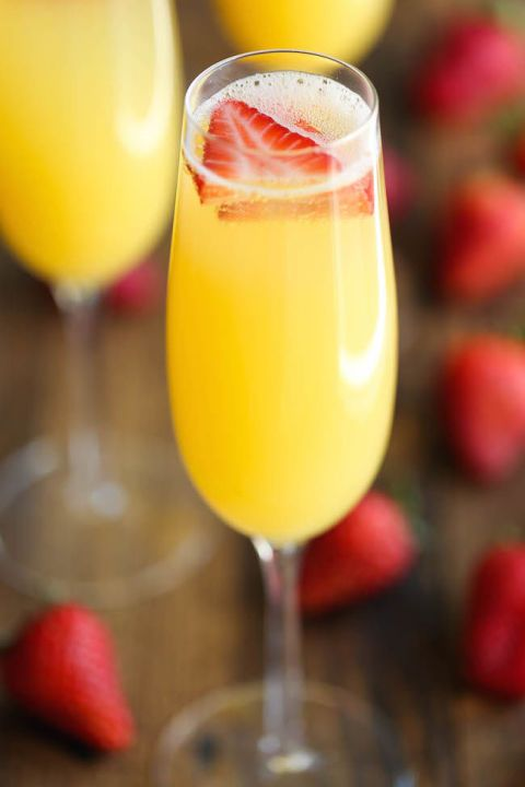 Simple but refreshing, this mimosa combines pineapple and orange juice—top with a few slices of fresh strawberry for an extra fruity touch.