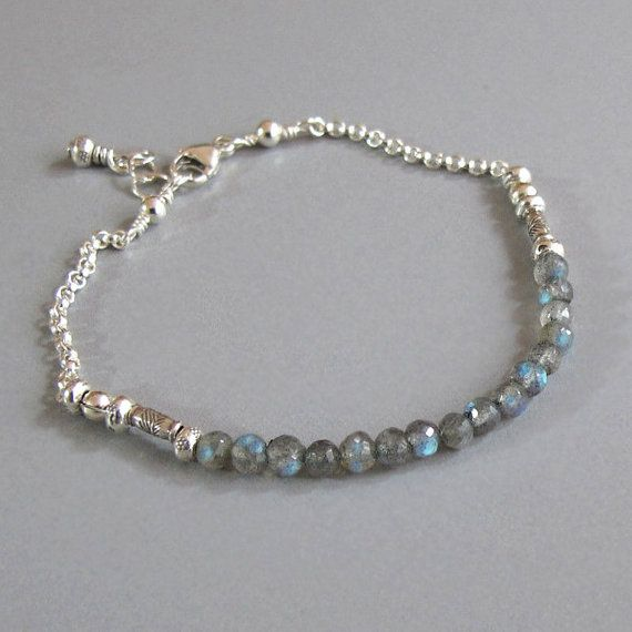 Tiny Labradorites rounds and handmade silver beads joined to a sterling silver chain encircle the wrist and close with a lobster clasp.    Beautiful
