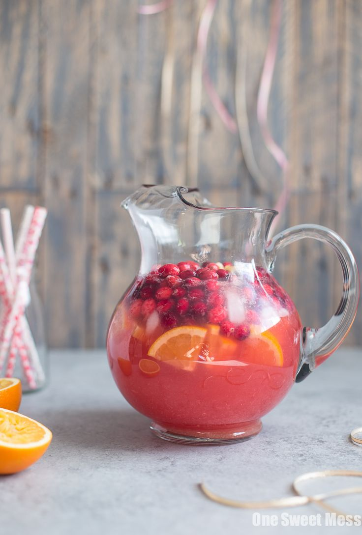 This Cranberry Orange Sangria is a holiday crowd pleaser. Its festive red color will have your guests flocking to the bar. 'Tis the season for big pitchers of festive sangria! Wine, fruit, vodka, and a splash of fizzy soda