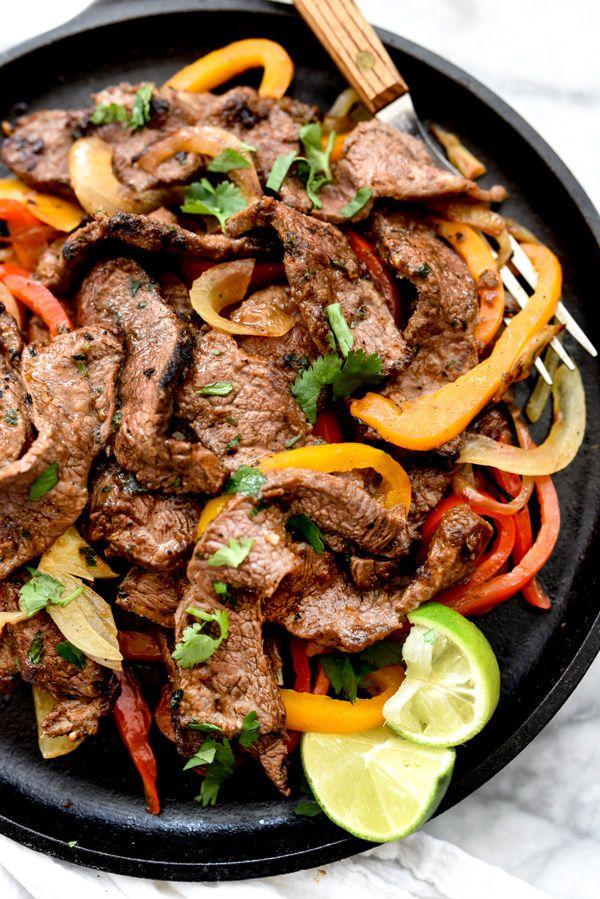 Say YES to The Best Steak Fajitas! Check out this recipe for a thin cut steak infused with a homemade spice blend-- fast, effortless, and insanely delicious!