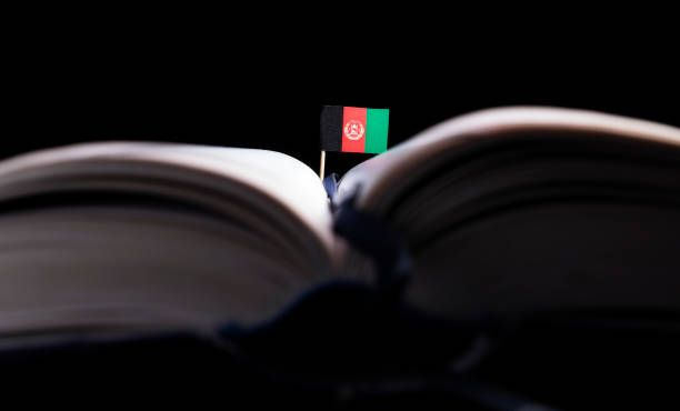afghanistan flag in the middle of the book knowledge and education