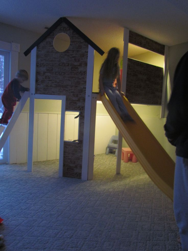 I built an 8'x4' 2 story indoor playhouse with a slide in our play room.  The door, kitchen and and more to be added soon.