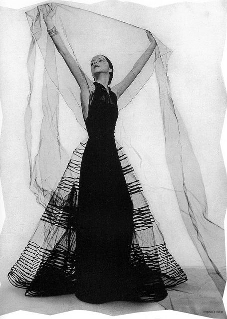 Vionnet's crinoline of black net with bands of chenile and diamond bracelets from Tiffany's, photo by Hoyningen-Huene, Harper's Bazaar, May 1936