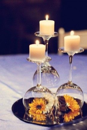 not sure if we need more table decorations but this would be a cute idea! we might not need the candles lit but it might be a nice way to add some color on to the white table cloths