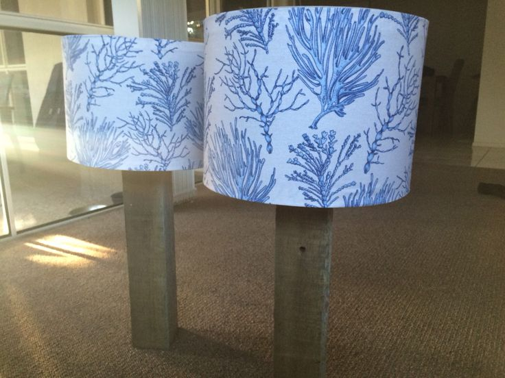 Recycled timber lamp base with homemade lamp shades.