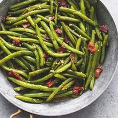 BROWN SUGAR GREEN BEANS WITH BACON  @cremedelacrumb1  2 pounds fresh green beans, ends trimmed 4-6 strips bacon, chopped (may sub turkey bacon) ⅔ cup brown sugar 2 tablespoons dijon mustard 1 tablespoon minced garlic salt and pepper to taste INSTRUCTIONS Place beans in a large pot and cover beans with water. Cover pot and bring to a boil over high heat. Boil until beans are tender, but not soggy (they are going to get cooked a bit longer later on so you don't want them overcooked at this…