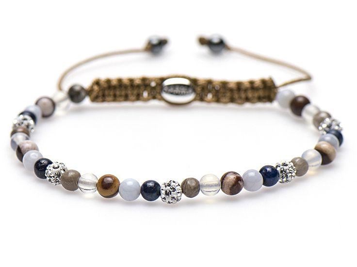 Karma Armband 'Spiral Perfect Wave' XXS 84154. Trendy en sprankelende KARMA armband met een lengte van 17-19 cm. De kralen zijn gemaakt van precosia kristallen en natuursteen. De kralen zijn handgeregen op een textiel, met het eenvoudige schuifsysteem kunt u de lengte naar wens aanpassen.
