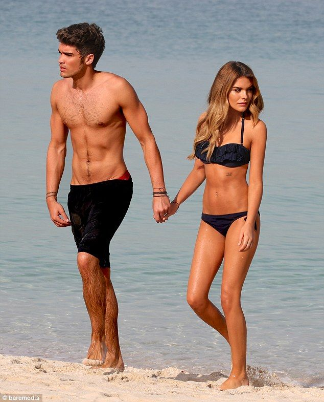 Hand in hand: Union J star Josh Cuthbert and girlfriend Chloe Lloyd enjoyed another day out in Dubai on Monday