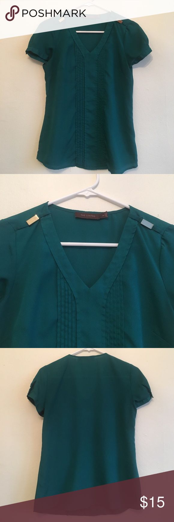 The Limited turquoise shirt with gold buckles I wore this a few times to the office with black or dark blue slacks and a suit jacket but looks great alone or with a cardigan, not super form fitting so it's comfortable to wear all day and doesn't stretch much so it won't shrink, size XS but fits like a normal small The Limited Tops Blouses