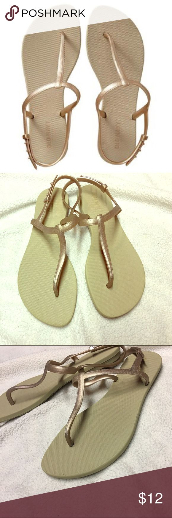 Gold Sandals Never worn! Perfect sandals for summer because they are a rubber material so water proof and easy to clean! Most reasonable offers accepted, or I love to bundle so check out the rest of my closet! Old Navy Shoes Sandals