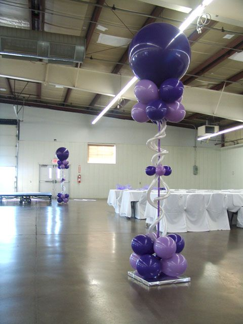 Beautiful wedding balloon columns-Make it all white with flowers and lights, and it could be elegant.
