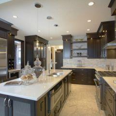 Dark kitchen cabinets with beige granite tops.   Like!