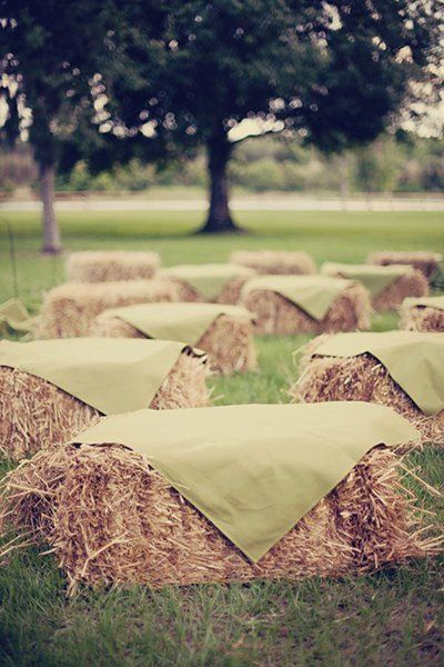 Bales of hay are the perfect ceremony seating for rustic backyard nuptials on the farm. Just don't forget to place fabric over them for an added layer of comfort.Related:Love, American Style: Barn Weddings