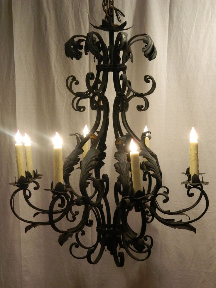 French Wrought Iron Eight-Light Chandelier | From a unique collection of antique and modern chandeliers and pendants  at http://www.1stdibs.com/furniture/lighting/chandeliers-pendant-lights/