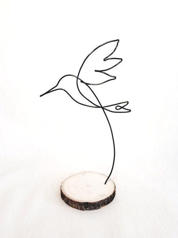 Wire sculpture flying hummingbird. Hand shaped from single