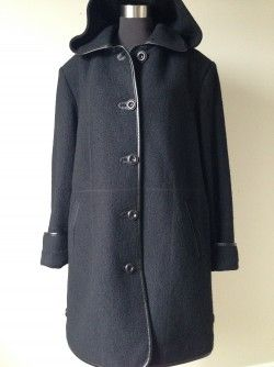 Niccolini Black Wool Coat, Sz 18 $60  This black wool blend coat is 50% Wool, 50% Viscose. Two front pockets, removable hood and faux leather trim.  Button up front.  New without tags Original Retail:  unknown but estimated between $190 – $210 plus tax Our Price:  $60