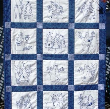 """A Quilt of Snowmen and Their Reindeer Buddies Embroidered in """"Chilly"""" BlueWork"""