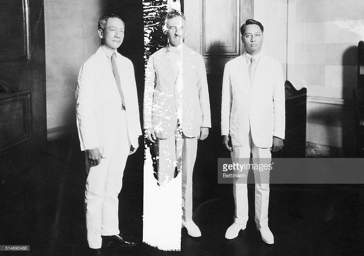 Left to right- Senator Sergio Osmena, the leader in the absence of Quezon, Governor General Stimson of the Phillipine Islands and Manuel Roxas, the Speaker of the House.