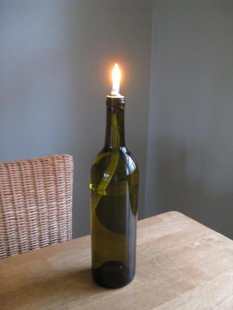 Make an oil lamp from a wine bottle! 12 More DIY Oil Lantern Ideas