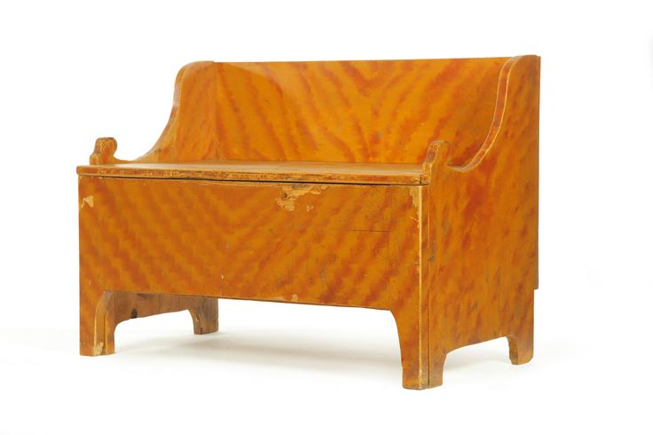 "DECORATED SETTLE BENCH.  Probably Midwestern, 1820-1840, pine. Unusual form with a lift lid and a pull-out ""hired man's"" bed. Retains its original red and yellow paint decoration. 30""h. 40.5""w. 23.25""d.  Estimate $ 1,200-1,500"
