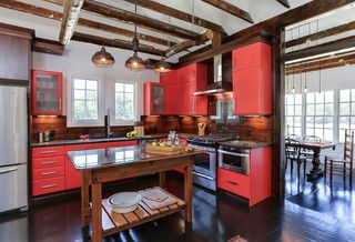 Buies Creek Farmhouse Cabico contemporary red cabinetry hung in an old farm house