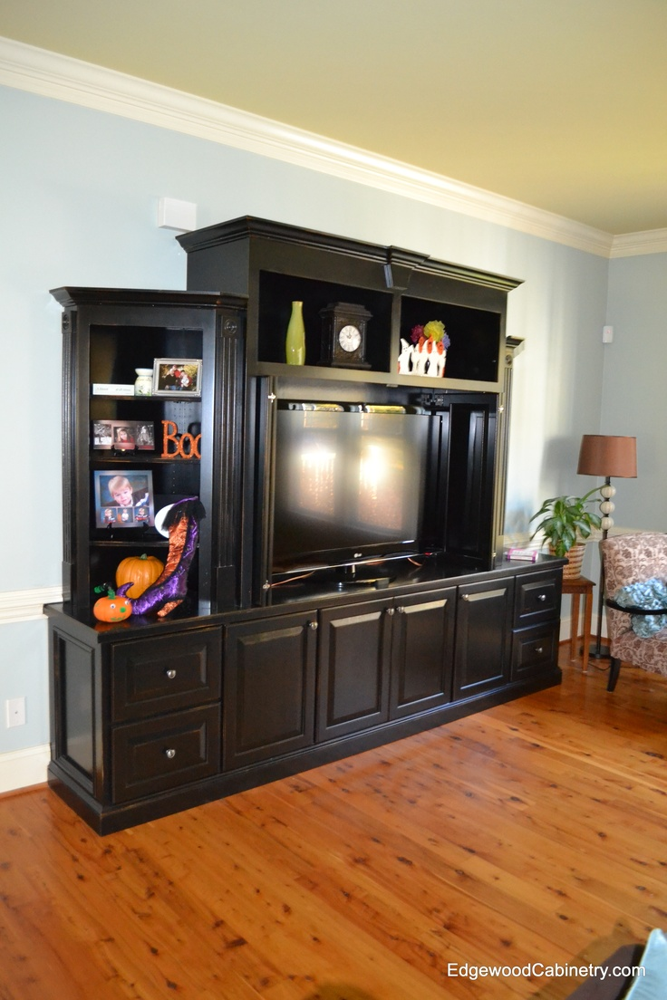 painted black entertainment center with open shelving and pocket doors for hiding the tv. Black Bedroom Furniture Sets. Home Design Ideas