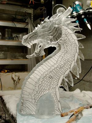 Arte Ghiaccio Animali (36) - ice sculptures | the incomplete dragon ice sculpture with a template still applied