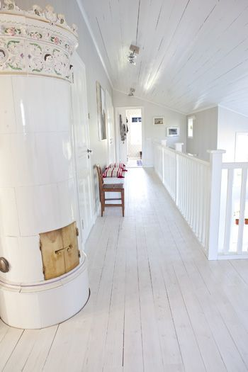 This is a little too devoid of color for me, but aaah! Just look at it! White floors are lovely. And that stove!