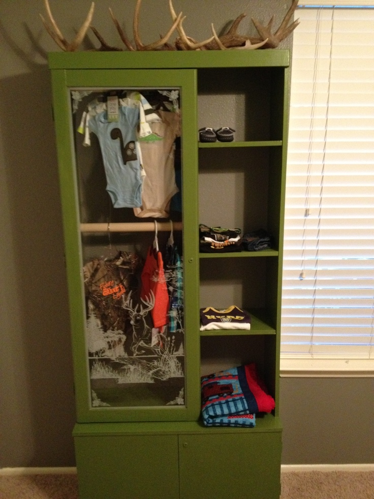 Baby Closet from Gun Cabinet. Thanks husband!