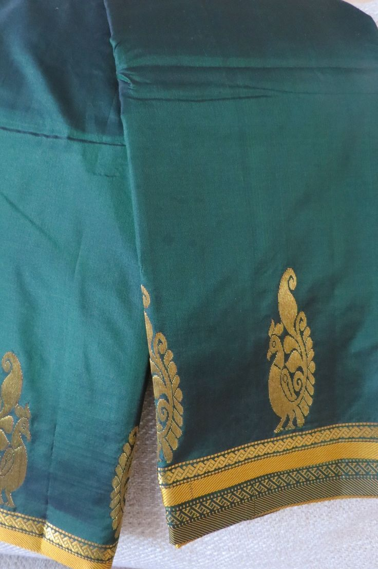 Your natural beauty will glow alongside this incandescent green Pure south indian Silk Saree. Small elegant peacock are woven at the bottom of the saree. The stunning golden border framing the saree with Gold zari motifs.