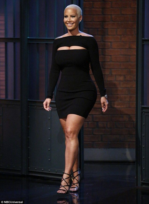 Little black dress: The model rocked a long-sleeved black dress with a front cutout...
