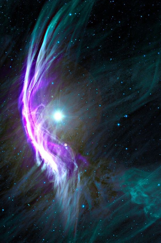 Zeta Ophiuchus, a massive star plowing through the gas and dust floating in space. Zeta Oph is a bruiser, with 20 times the Sun's mass. It's an incredibly luminous star, blasting out light at a rate 80,000 times higher than the Sun! Even at its distance of 400 light years or so, it should be one of the brightest stars in the sky … yet it actually appears relatively dim to the eye.
