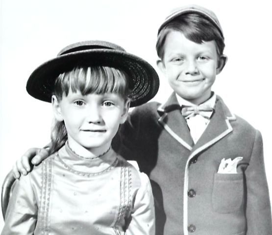 Jane and Michael Banks. The girl playing Jane played a maid in Upstairs,Downstairs when she grew up.
