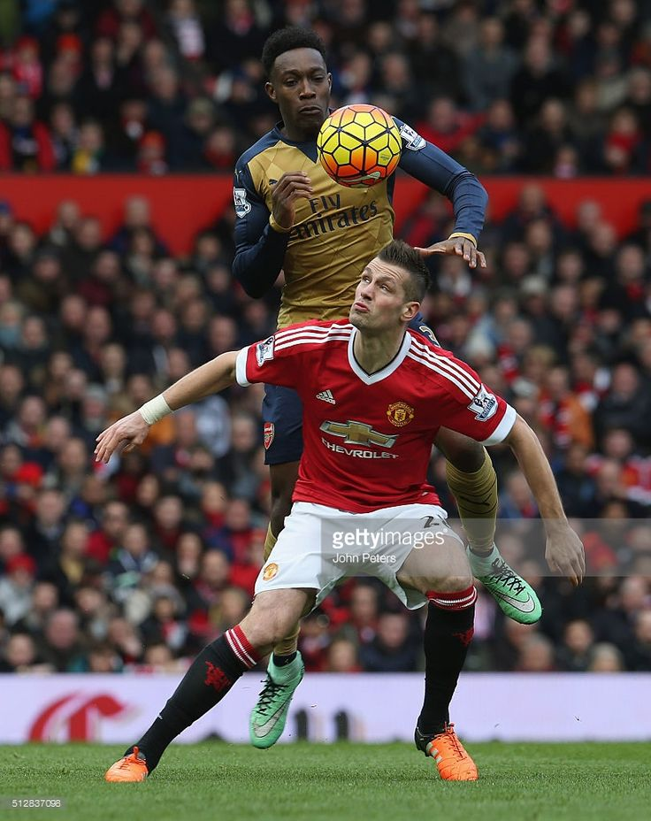 Morgan Schneiderlin of Manchester United in action with Danny Welbeck of Arsenal during the Barclays Premier League match between Manchester United and Arsenal at Old Trafford on February 28 2016 in Manchester, England.