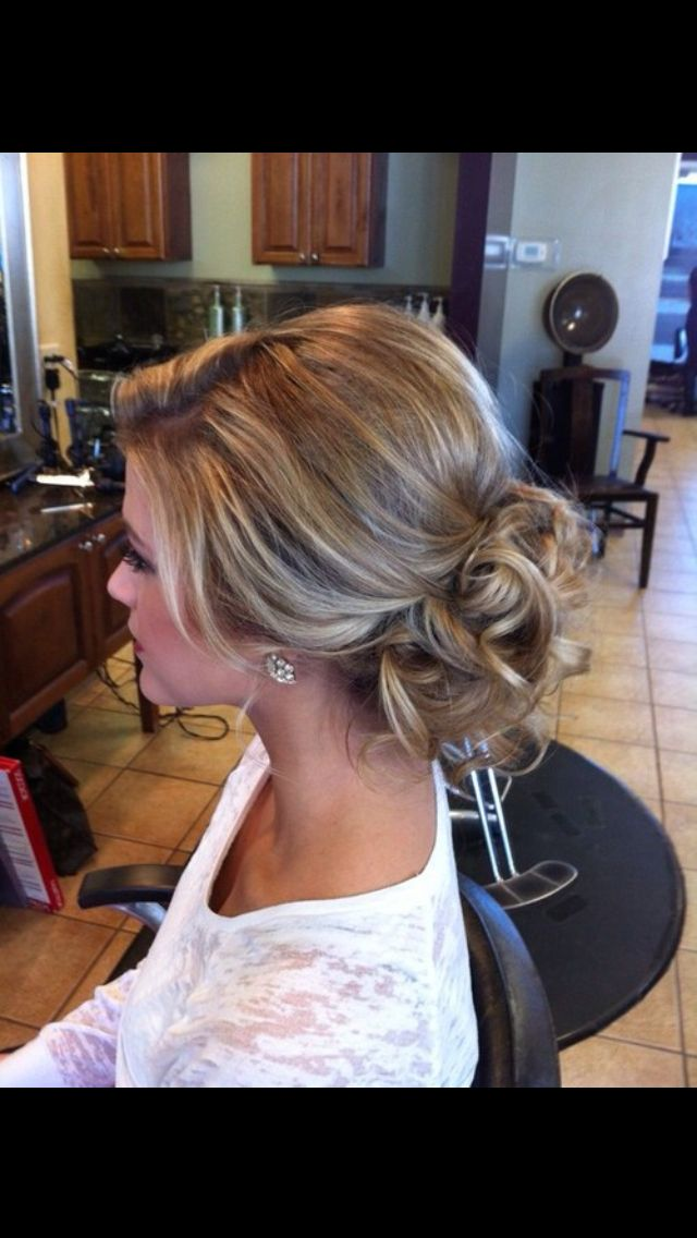 I hate when brides wear their hair down on their wedding day. There is nothing more elegant and classy than an updo.