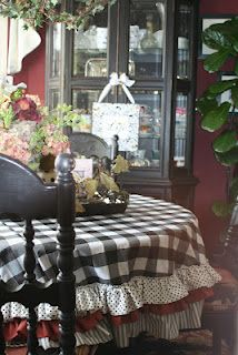 Checker Ruffled tablecloth--this lady has the most adorable decorating ideas, some as simple as using duct tape!