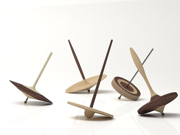 Sixteen Porro wood-essences for the spinning tops designed by Piero Lissoni