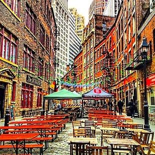Stone Street during happy hour:    Go for: all of the suits, if you're into suits.  Stay for: the cute cobblestone streets.