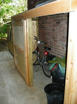 Small storage shed with sliding door - pretty easy to add to the side if the fence