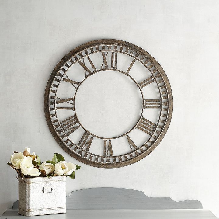 Magnolia Home Aged Roman Numeral Wall Decor.  Create a stunning focal point in any room with this striking decor with iron construction that lends an aged appearance. Part of the Magnolia Home Collection by Joanna Gaines.