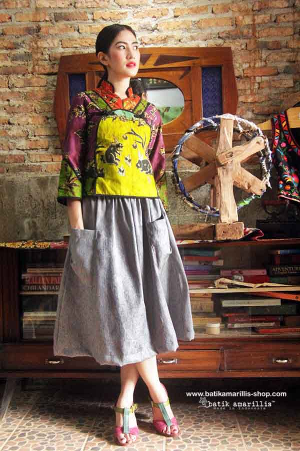 Batik Amarillis Project A #2 Jacket  Continuing our iconic Project A series now coming  in a new style : A well tailored jacket ,with signature 'A' aplique at front also features criss crossed color combos to frame out the whole look  plus 3 hand made chinese frog buttons!Together with Batik Amarillis's paper bag skirt will create a statement,both are dedicated for women who's not afraid to stand out in the crowd.